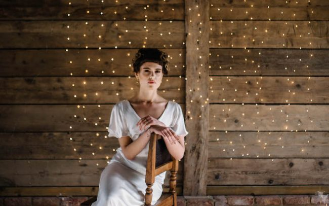 Wedding lights and bride wearing Tara Deighton