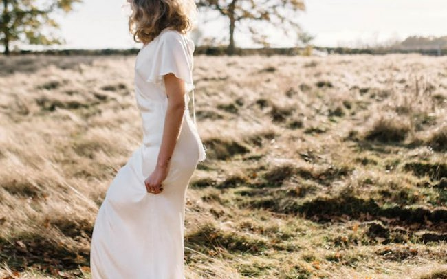 Outdoor wedding and bride wearing Tara Deighton
