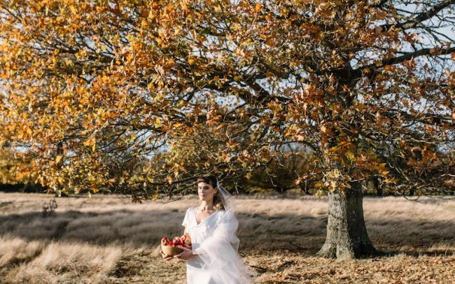 Outdoor wedding and bride wearing Tara Deighton