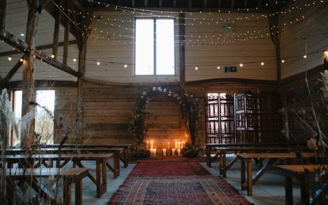 Indoor wedding ceremony by Hire Love